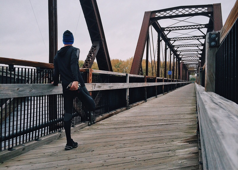 balanced lifestyle fitness runner on bridge